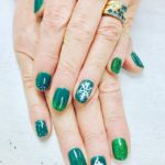 Green glitter nails with nail art
