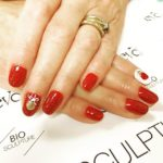 Red glitter nails with nail art